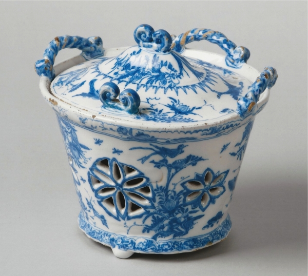 A Dutch Delft blue and white basket made for a dressing-table
