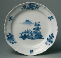 One of a pair Dutch blue and white faience chargers