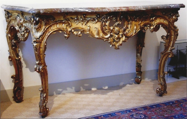 A French carved and gilded Louis XV console-table with a marble top