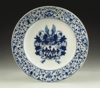 A Dutch blue and white faience charger, depicting a coat of arms