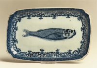 One of a pair of blue and white Chinese export porcelain herring-dishes, after a Dutch Delft original