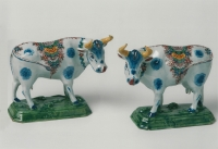 A pair of Dutch Delft polychrome figures of cows