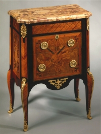 A French transitional ormolu-mounted marquetry commode