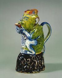 A Dutch Delft polychrome milk jug in the form of a monkey