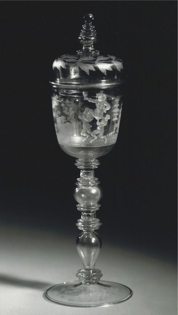 A covered goblet, engraved with a representation of Bacchus carried by two satyrs