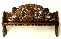 A Dutch carved pine hall bench