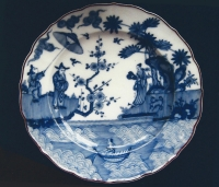 A Dutch blue and white porcelain plate, decorated with a landscape after a Japanese example