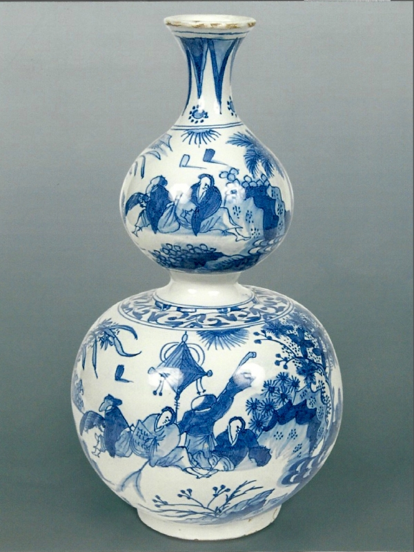 A Dutch Delft blue and white double-gourd shaped vase with Chinoiserie decoration