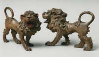 A pair of polychrome limewood lions