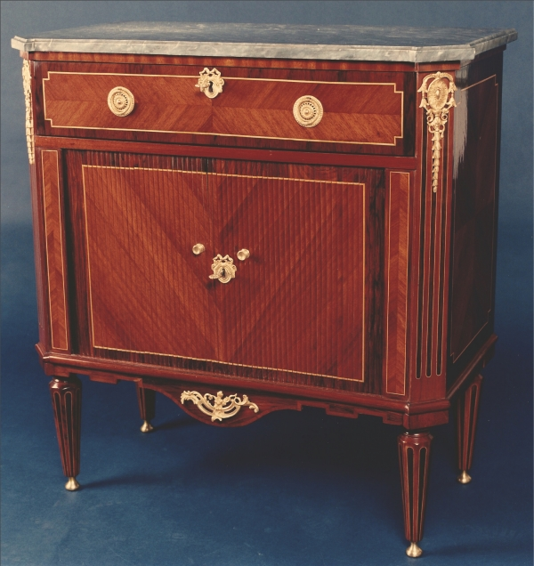 A Dutch Louis XVI ormolu mounted kingwood and amaranth commode with a writing draw