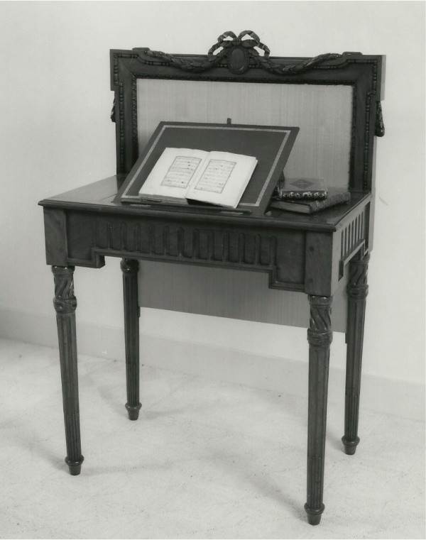 A Dutch Louis XVI mahogany reading-table with a fireplace screen