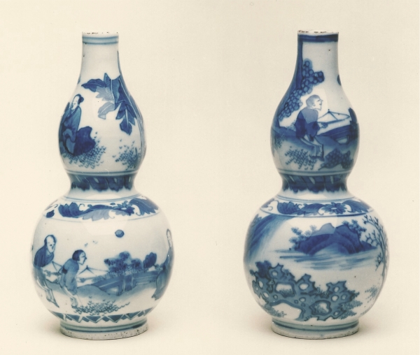 A pair of blue and white double-gourd Chinese porcelain bottles