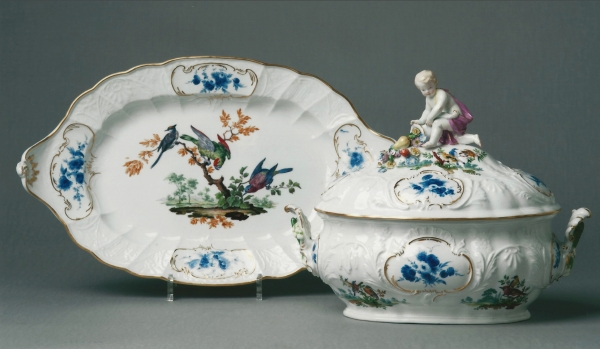 A two-handled oval polychrome porcelain tureen with cover and stand