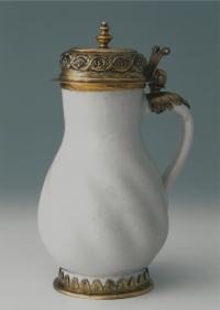 A Frankfurt white faience jug with original gilded silver mounts
