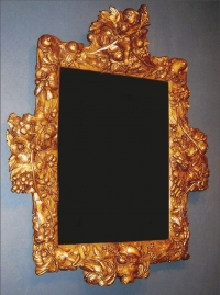 A mirror in a 17th century Dutch carved and gilded limewood frame