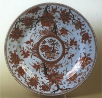 A Chinese porcelain dish, decorated in red, brown and gilt