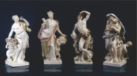 A set of four polychrome porcelain figures, depicting the four seasons