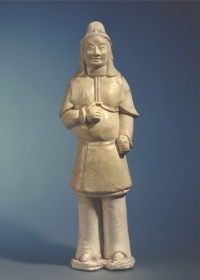 One of a pair of Chinese partly-glazed earthware guards