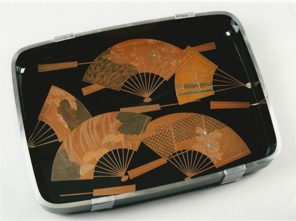 A black laquered kimono tray, with gold laquer decoration depicting various fans