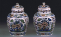 A pair of Dutch Delft  cachemire-palette ovoid jars and covers