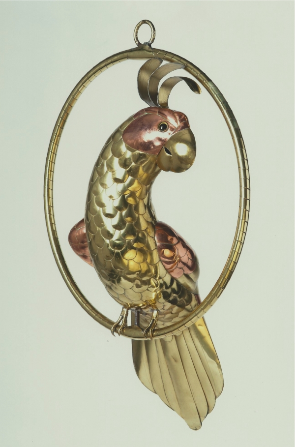 A brass figure of a cockatoo
