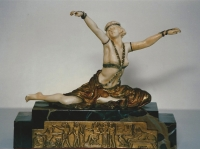 A sculpture of ivory and gilded bronze, on a marble base